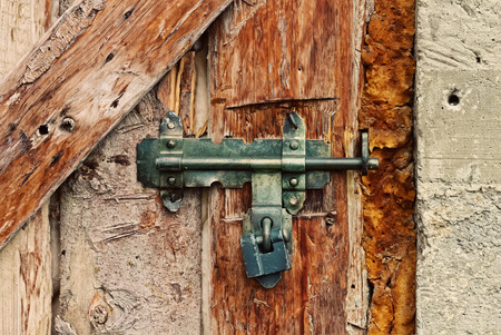 foam safe: Latch with padlock on a old wooden door Stock Photo