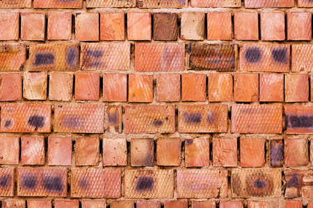 lopsided: Red brick wall from big blocks, textured background Stock Photo