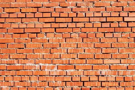 lopsided: Red brick wall, texture grunge background