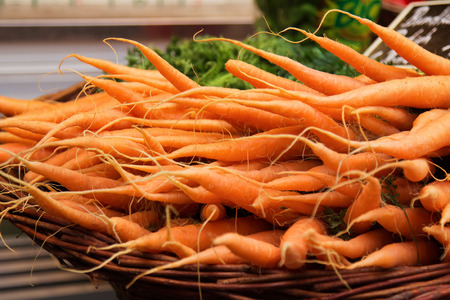 low cal: Colorful carrots in a basket at market.