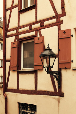 balk: Fragment of facade of medieval house with lantern in old town Nuremberg, Germany
