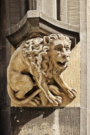 detai: Stony gothic figure of lion on Town Hall in Marienplatz, Munich, Germany