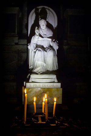 pius: Venice - 12 November, 2016: Candles in front of the statue Pope Saint Pius X in the church of San Salvador (the Holy Savior), Venice, Italy Editorial
