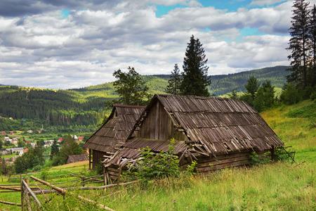 damaged roof: Abandoned house in Carpatian mountains, Ukraine.