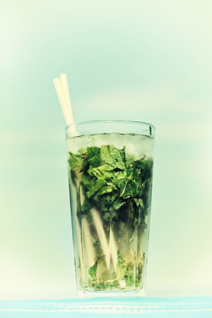 misted: One misted glass of cocktail mojito over blue sky background Stock Photo
