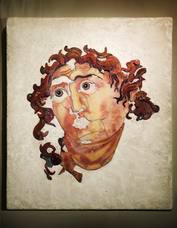 ROME - APRIL; 22: Marble head of Helios (he was the personification of the Sun in Greek mythology) in opus sectile; first thirty years of the 3th century AD; Museum in Colosseum; Rome; Italy Editorial