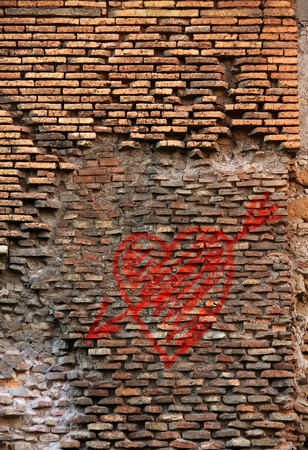 Red brick wall with  lop-sided rustication, texture grunge background Stock Photo
