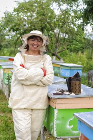 Portrait of a woman beekeeper Beekeeper stock Stock Photo