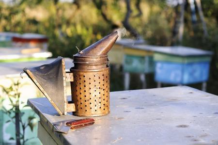 Smoker for bees, beekeeper tool beekeeping, apiarist Stock Photo