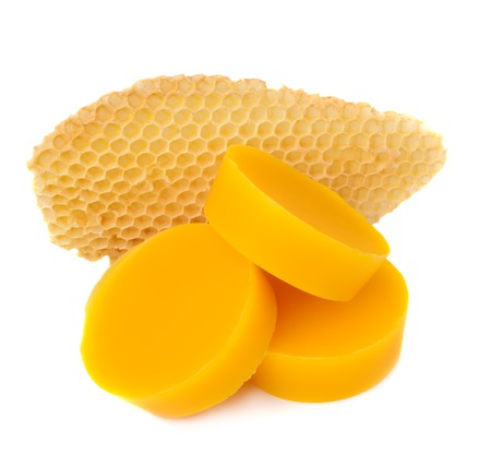 Pieces of natural beeswax and a piece of honey cell are isolated on a white background. Beekeeping products. Apitherapy