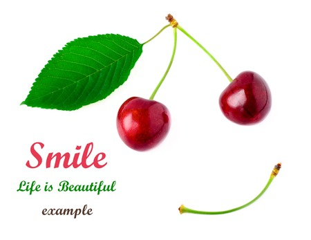 Two red cherries with a yellow green leaf on a white background. Smile concept. Don't worry Be Happy