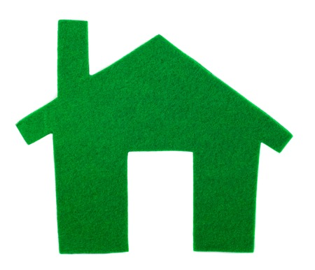 Green house with felt on a white background. The concept of a new home. Buying a new home. Stock Photo