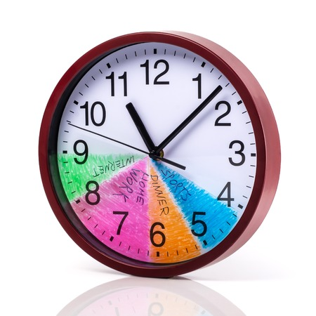 Time management concept: Round clock with a colored dial and action plan for a day on a white background. Imagens