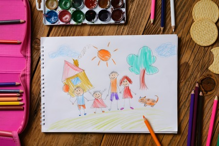 Photo of a childrens picture on a theme - My happy family, painted with colored pencils. Psychological testing of the child using the picture.
