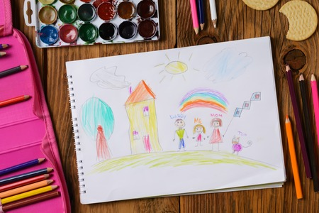 What can a childrens picture tell. Photo of a childrens picture on a theme - My happy family, painted with colored pencils. Psychological testing of the child using the picture. Stock Photo