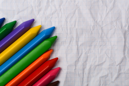 Colored pencils on a piece of paper with free space for text. Stock Photo