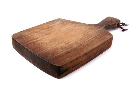 Old wooden cutting board on a white background.