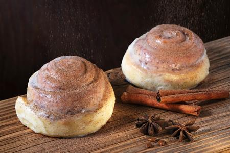 Sinnabon buns. Sinabon rolls with cream cheese. Sinabon - Homemade cinnamon baking. 写真素材