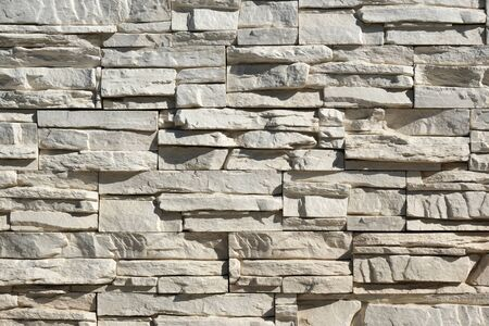 Seamless texture, background, stone lined with granite walls. sandstone. stone background wall. Facing Stone. Reklamní fotografie
