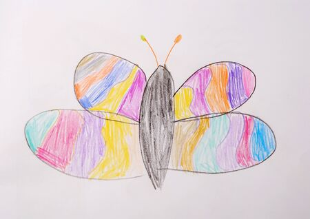 Photo of childrens drawing. Butterfly painted with colored pencils. Reklamní fotografie