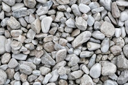 Background made of a closeup of a pile of pebbles.