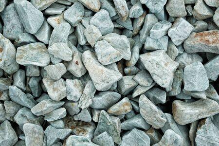 Decorative stone building pebbles close-up macro photo stone designer background. Green Marble Pebble