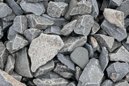 Decorative stone building pebbles close-up macro photo stone designer background. Gray Marble Shingle Reklamní fotografie