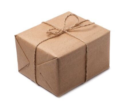 Brown paper parcels ready to be shipped brightly lit on isolated white background.