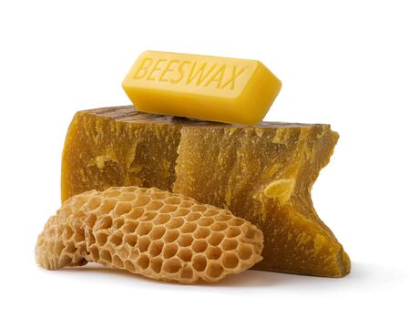 How to get natural organic beeswax. Pieces of organic beeswax on a white background. The use of beeswax in apitherapy. Production Ingredient for Medical and Cosmetics Standard-Bild