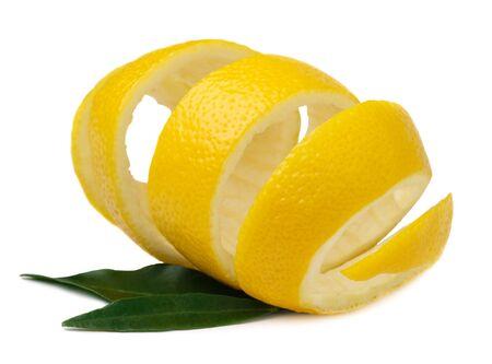 Useful properties of lemon peel. Lemon peel with green lemon leaves isolated on a white background. Use of lemon peel in cooking and medicine