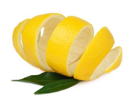 Lemon peel with green lemon leaves isolated on a white background. Use of lemon peel in cooking and medicine. Reklamní fotografie