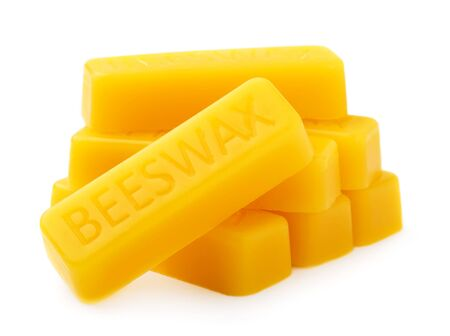 Bars of natural organic beeswax isolated on a white background. Production Ingredient for Medical and Cosmetics. The use of beeswax in apitherapy
