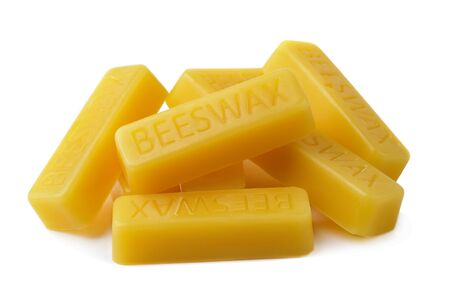 Beeswax on a white background.Beeswax blocks. Natural beeswax. 写真素材