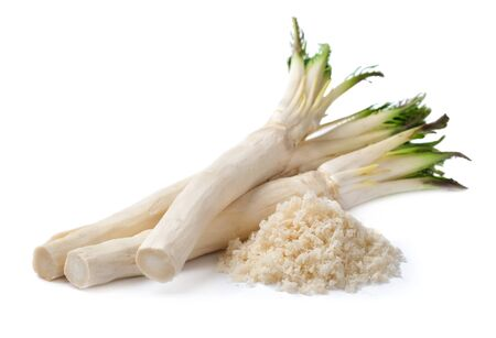Horseradish root with leaves on white background. Reklamní fotografie