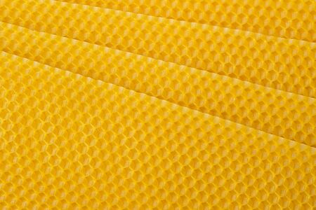 Beeswax. Wax base for honey bee rebuilding. Honeycomb. Natural honeycomb bee background. 写真素材
