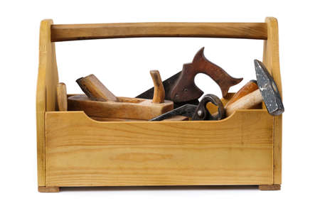 Wooden toolbox with tools isolated on white.