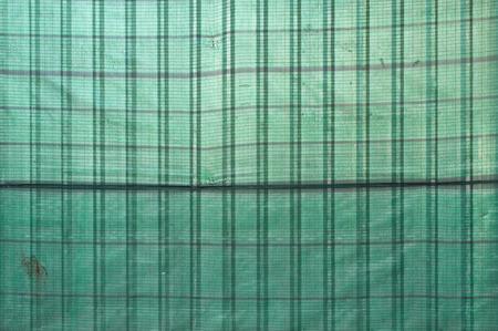 to shading: green shading net background Stock Photo