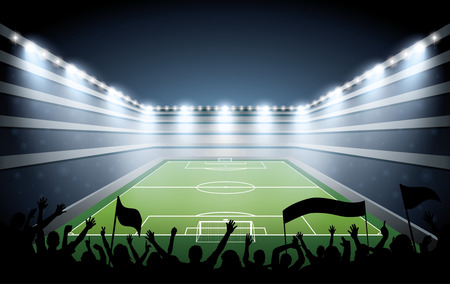 Opgewonden menigte van mensen op een voetbalstadion.