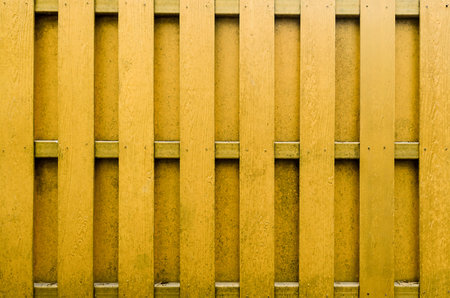 panelling: yellow wooden fence background.