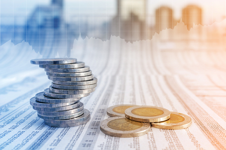 news paper: Business concept, coin stacks on news paper with financial graph stat business background. Stock Photo