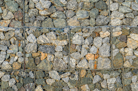 prevent: Stone walls prevent landslides in country road. abstract background.