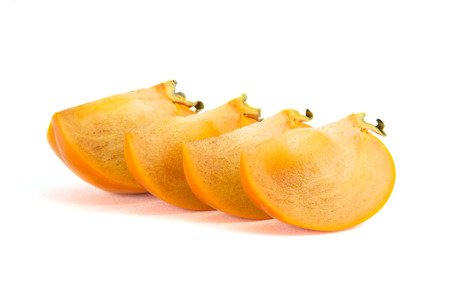 Sliced of persimmons isolated on white background.
