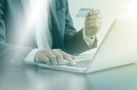 Business man using computer with a credit card to shopping online. Stock Photo
