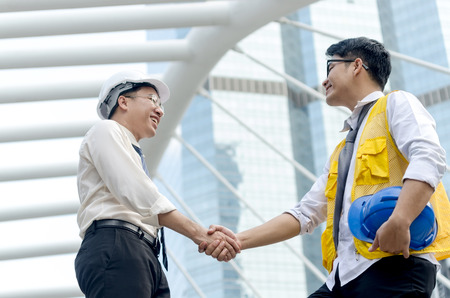 asian architect: Business handshake. Architects handshake and business people concept. Partnership, Deal.  Stock Photo