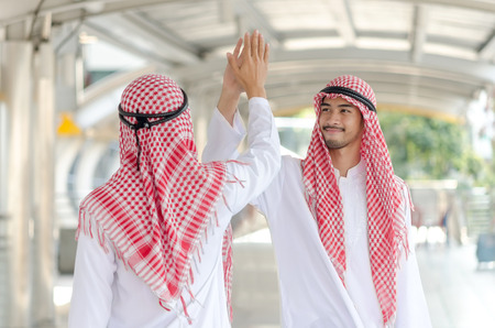 Arab businessman touching hands together at business walk way area.