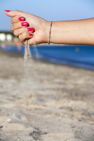 letting: Hand letting sand at the beach