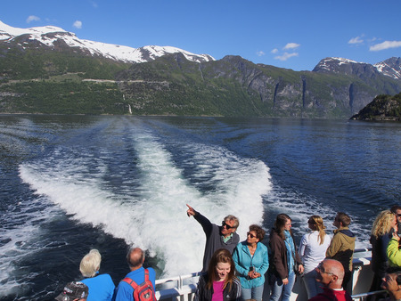 water scape: Geiranger fjord, mountains, summer, june 28, Tourists travel to the Geiranger fjord on a cruise ship