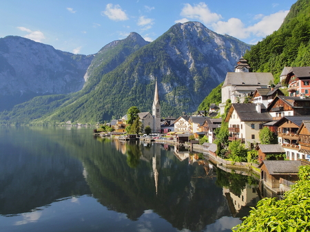 Hallstatt village and alpine lake in morning lights. Austrian Alps Stock Photo