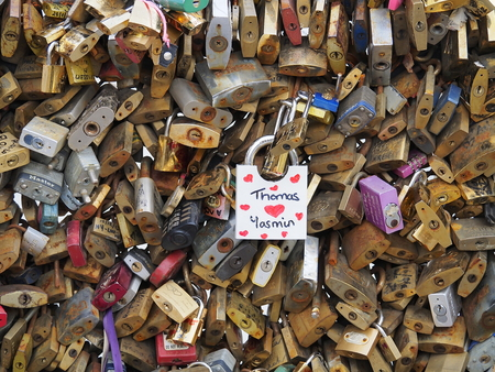 inseparable: France, Paris, October 12, 2015 thousands of padlocks on the bridge symbolize the eternal love forever. Editorial