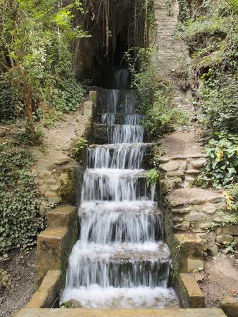 granite park: Water flows through the granite steps. Summer, Park, Granada, Spain